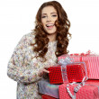 Picture of cheerful santa helper girl with gift box — Stock Photo #15604833