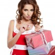 Christmas gift. Woman giving,holding christmas present. — Stock Photo #15605057