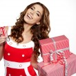 Christmas gift. Woman giving ,holding christmas present. - Stock Photo