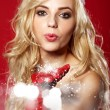Photo of fashion Christmas girl blowing snow.  — Foto de Stock
