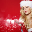 Stock Photo: Photo of fashion Christmas girl blowing snow.