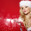 Photo of fashion Christmas girl blowing snow. — Stock Photo #15607087