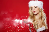 Photo of fashion Christmas girl blowing snow. — Stock Photo
