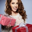 Beautiful brunette woman with a gift boxes — Stock Photo #15627571