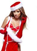 Krásná mladá žena v šatech santa claus — Stock fotografie