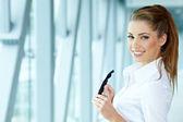 Businesswoman standing inside a modern house — Stock Photo