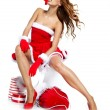 Portrait of young, sexy female Santa isolated on white — Stock Photo #15876209