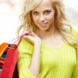 Royalty-Free Stock Photo: Beautiful woman in town holding shopping bags