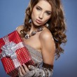 Beautiful brunette woman with a gift boxes — Foto Stock