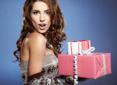 Girl opening x-mass present isolated on grey background — Stock Photo