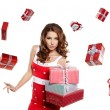 Young woman with gifts. Shot in studio. — Stock Photo #16630923