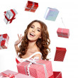 Beautiful brunette woman with a gift boxes — Stock Photo #16631131