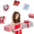 Stock Photo: Attractive woman with many gift boxes and bags.