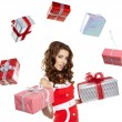 Attractive woman with many gift boxes and bags. — Stock Photo
