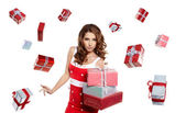 Young woman with gifts. Shot in studio. — Stock Photo