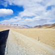Yellowish mountain road view in tibet of China - Stock Photo