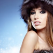 Portrait of a beautiful lady in fur cap — Stock Photo #16919633