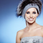 Portrait of a beautiful lady in fur cap — Stock Photo #16919725