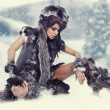 Winter wild woman on snow — Stock Photo #16944759