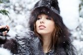 The beautiful woman in winter wood — Stock Photo