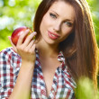 Portrait of beautifu young woman with a basket of fruit at summe - Stock Photo