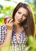 Portrait of beautifu young woman with a basket of fruit at summe — Stock Photo