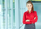 Portrait of happy smiling young businesswoman in office — Stock Photo