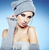 Beautiful woman in warm clothing on blue background — Stock Photo