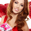 Happy young woman holding gift — Stock Photo