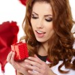 Valentine's Day. Beautiful smiling woman with a gift — Stock Photo #18520479