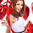 Beautiful fashion woman in red posing with red ballons — Stock Photo #18719215