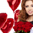 Young beautiful woman smelling a bunch of red roses — Stock Photo #18719687