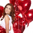 Woman with red heart balloon — Stock Photo #18719813