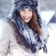 Beautiful girl in the park in winter — Stock Photo #18833069