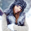 Beautiful girl in the park in winter — Stock Photo #18833275
