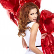 Beautiful young woman with a heart-shaped balloons — Stock Photo