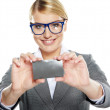 Young friendly businesswoman handing a blank business card  — Stock Photo #19052603