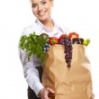 Portrait of happy business woman holding a shopping bag full of — Stock Photo