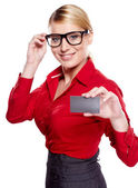 Young friendly businesswoman handing a blank business card — Stock Photo
