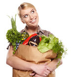Woman with a shopping bag filled with nutritious fruit and veget — Stock Photo