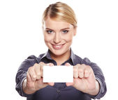 Businesswoman holding credit card. Isolated on white — Stock Photo