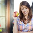 Apple woman. Very beautiful model eating red apple in the park. — Stock Photo