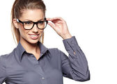 Eyewear glasses woman closeup portrait. Woman wearing glasses ho — Stock Photo