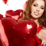 vrouw met rood hart ballon op een witte achtergrond — Stockfoto #19167611