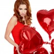 Woman with red heart balloon on a white background  — Stockfoto