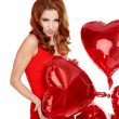 Woman with red heart balloon on a white background  — ストック写真