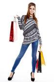 žena držící nákupní tašky proti bílému pozadí — Stock fotografie