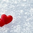 Stock Photo: Two hearts in the snow