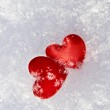 Two hearts in the snow — Stock Photo