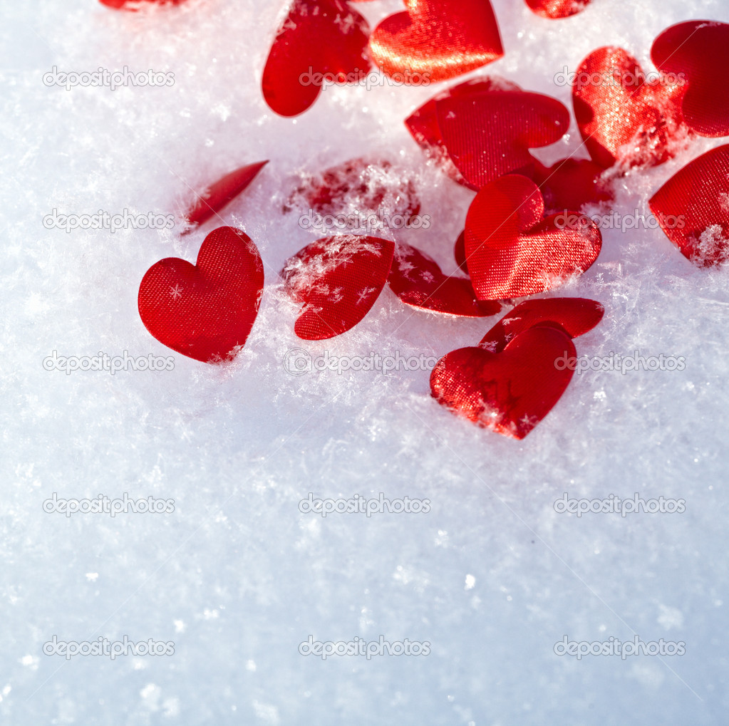 Red hearts on snow  — Stock Photo #19382735